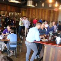 The Young Alumni Council gather at Founders Brewing Co.